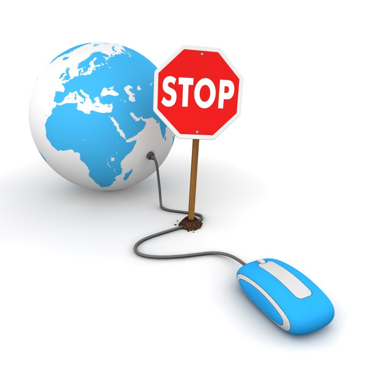 Surfing the Web in Blue - Blocked by a Stop sign © - Fotolia.com