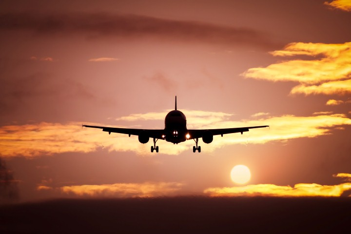 plane in the sunset sky © magann - Fotolia