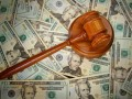 court gavel on U.S. Twenty dollar bills © zimmytws - Fotolia