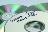 Piracy concept with Pirate Movie written on a dvd © gcpics - Fotolia
