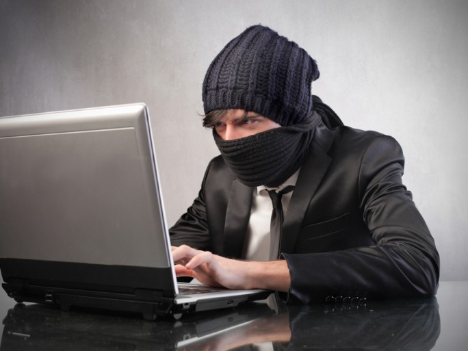 ninja security hacker suit business - (c) olly shutterstock