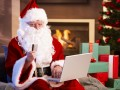 Father Christmas Santa Claus Email Laptop © StockLite Shutterstock