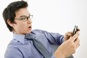 Man surprised at text message.