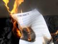 burning contract on fire © Valeriy Lebedev Shutterstock
