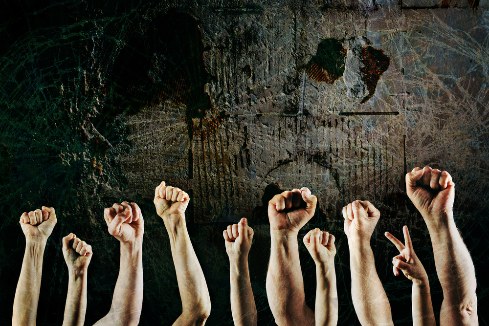 Strike protest complaint arms fists © Shutterstock Suzanne Tucker