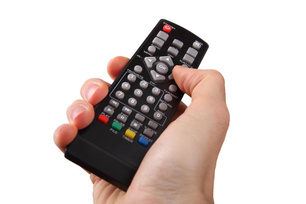 TV remote control hand © gielmichal Shutterstock