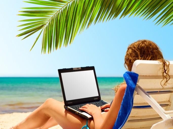 laptop beach, remote working holiday © Sergey Peterman Shutterstock