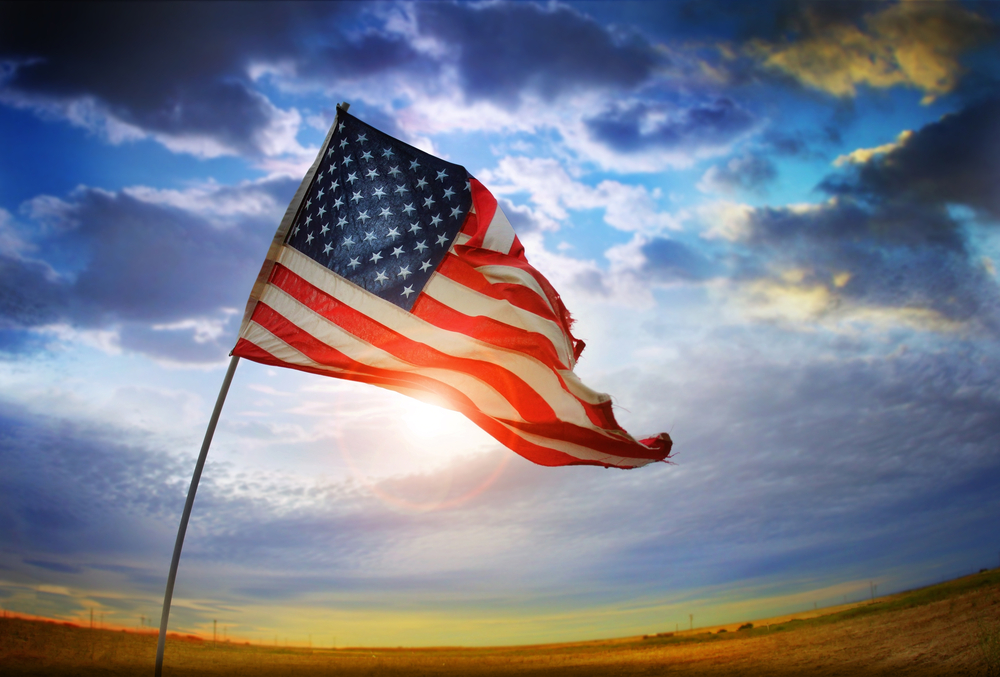 American cloud flag tattered © CURAphotography Shutterstock