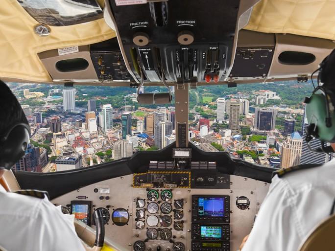 airline pilot city landing plane flight Shutterstock