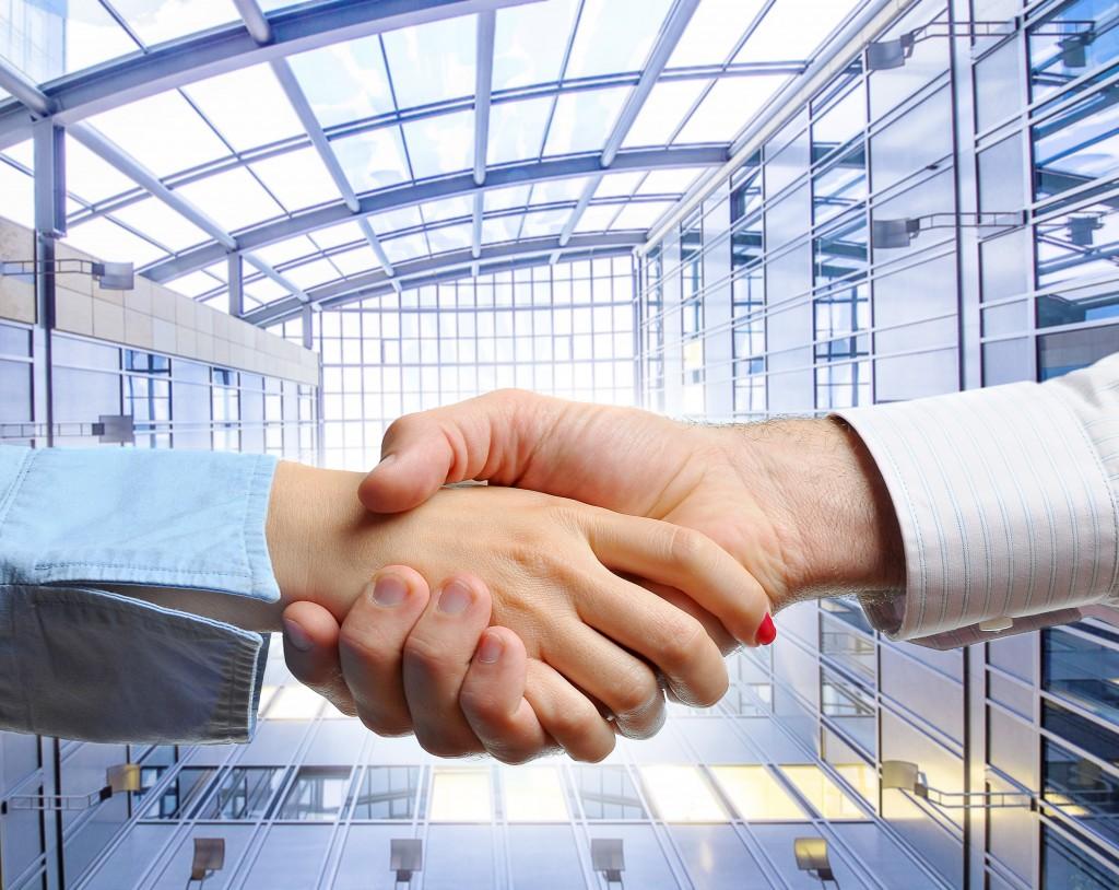 acquisition handshake ©Drazen shutterstock