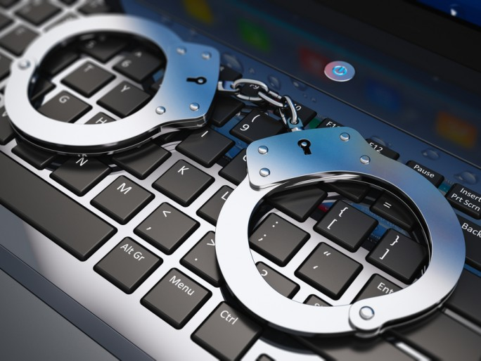 police handcuff security crime keyboard © Oleksiy Mark Shutterstock