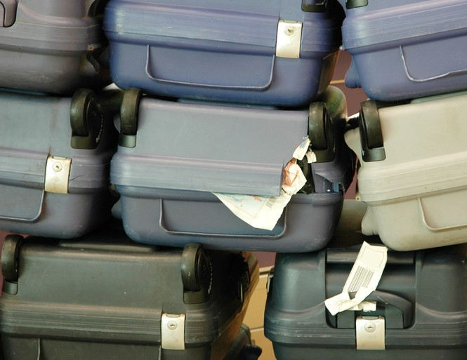 airport luggage problem suitcases travel © Johnny Lye Shutterstock