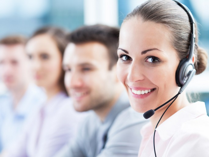 helpdesk support call centre phone happy © Edyta Pawlowska Shutterstock