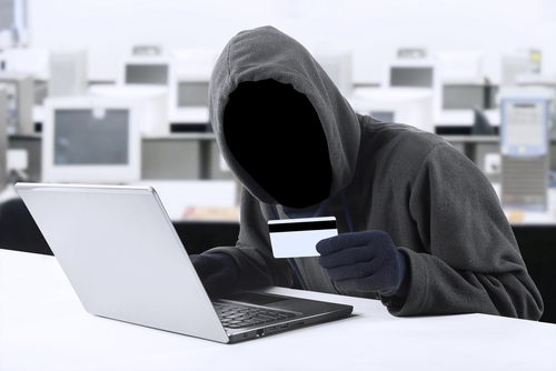 Hacker, cyber crime, criminal, bank cards © Creativa, Shutterstock 2014