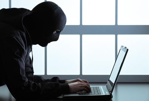 Hacker, cyber crime © Stokkete, Shutterstock 2014