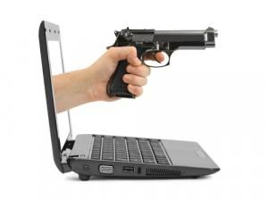 Ransom, gun, laptop, crime © Tatiana Popova, Shutterstock 2014