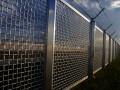 National border security fence firewall guard boundary data © Bertold Werkmann Shutterstock