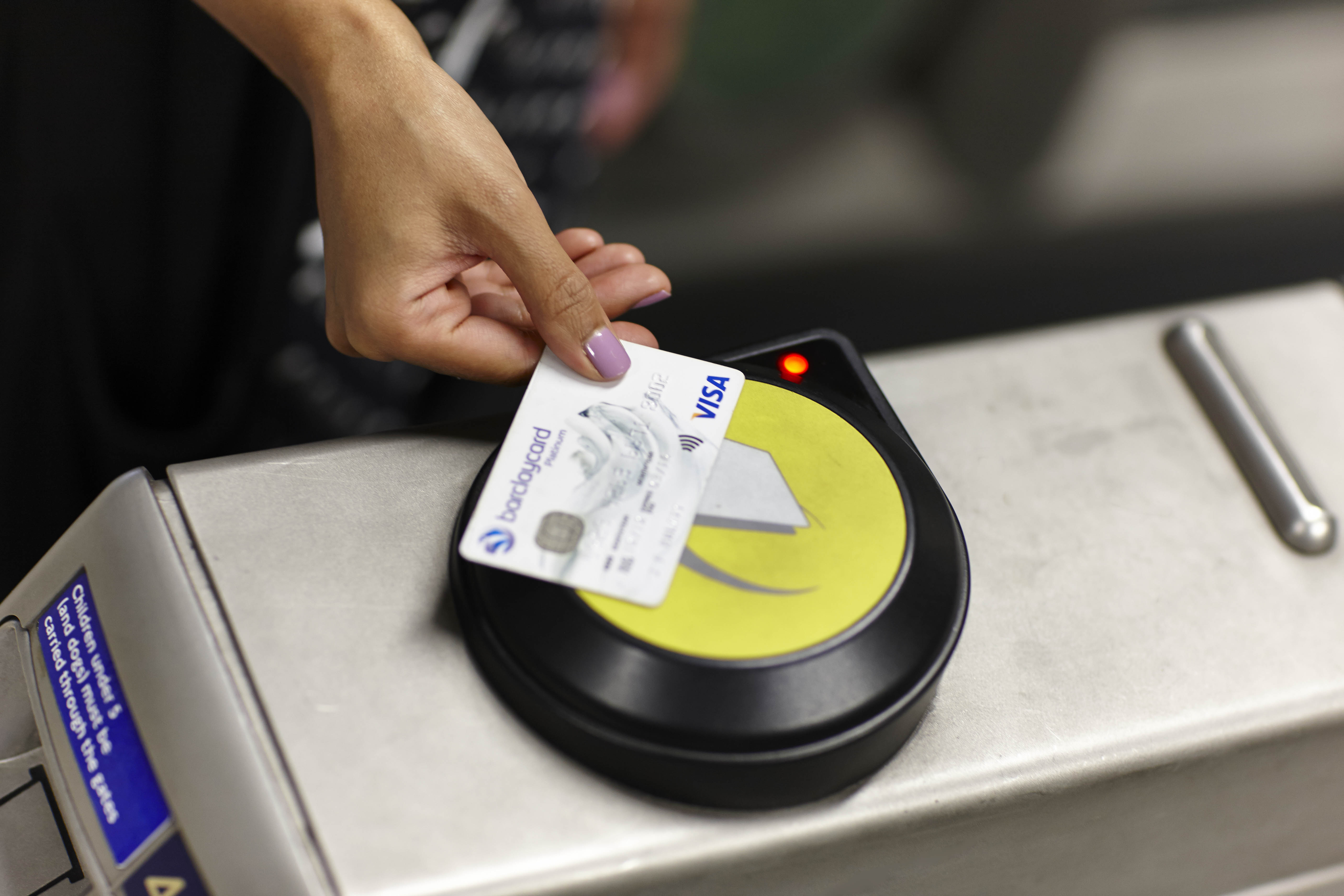 A touch payment is demonstrated as Visa Europe launches contactless payments