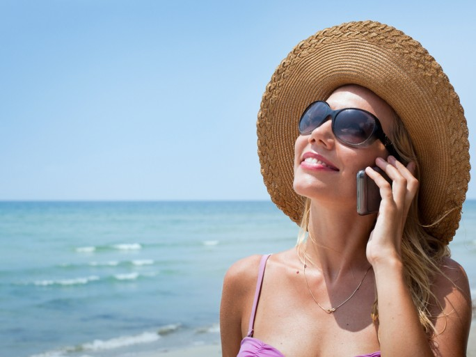 roaming mobile phone beach ©Ditty_about_summer / shutterstock