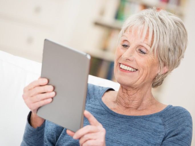 elderly woman using tablet ©racorn / shutterstock.com
