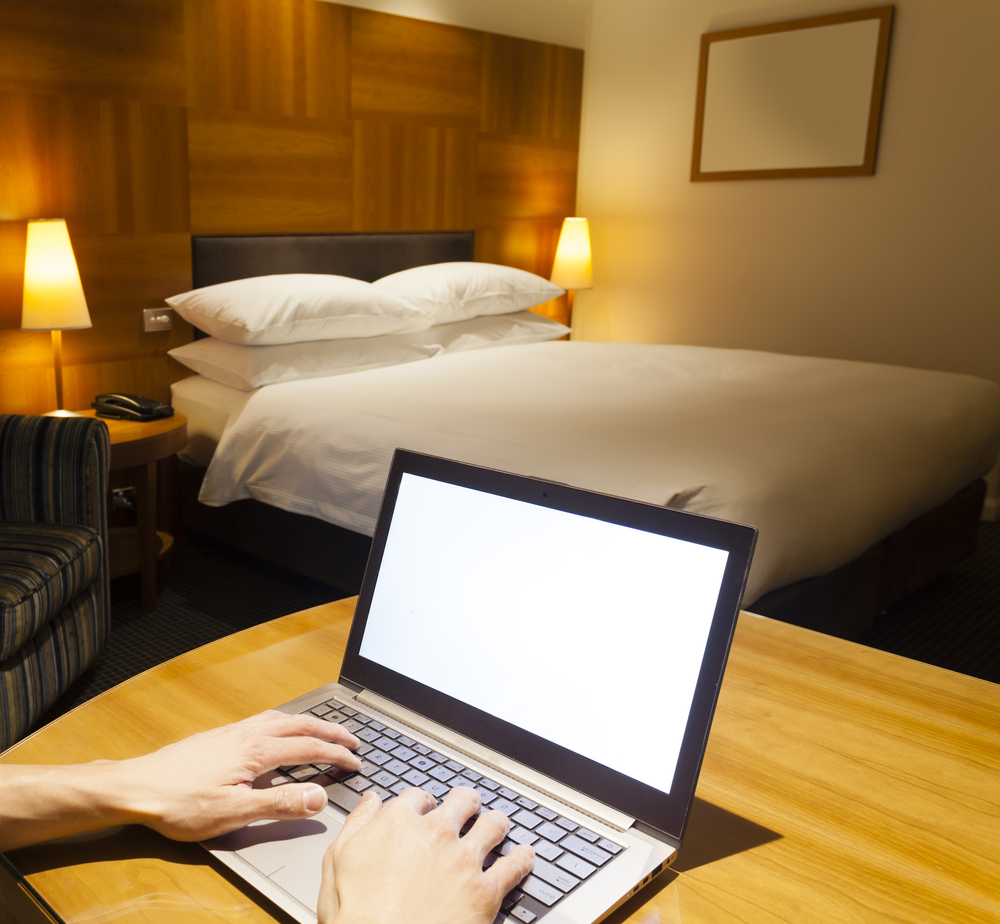 hacking with a laptop in hotel room