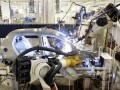 Robots making a car in factory
