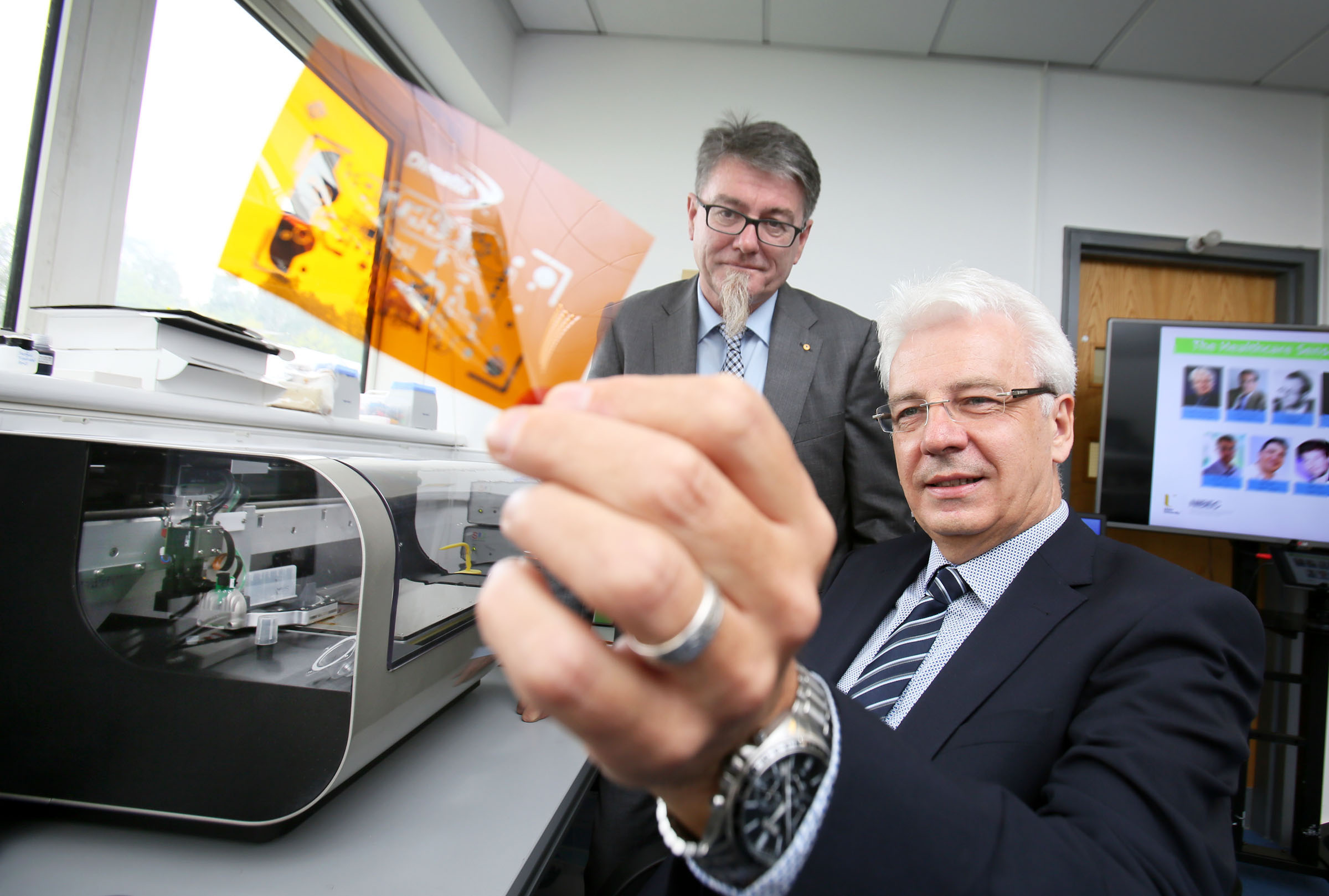 One of the worldÕs leading scientists in the field of electromaterials, Belfast-born Professor Gordon Wallace (right) from the University of Wollongong, Australia, helped launchÊUlster UniversityÕs new £2 million Health Technology Research Hub at the Jordanstown campus today with Professor Jim McLaughlin, Ulster University. ÊWorking with medical personnel and industry, the hubÊwill make a global impact on healthcare costs and improve patient treatment for a range of conditions by ensuring that new ideas and technologies can be rapidly tested and developed for use by clinicians. ÊPic By Paul Moane / Aurora