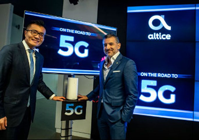 Altice Portugal chief executive Alexandre Fonseca and Huawei Portugal chief Chris Lu are shown at a 5G technology demonstration in July 2018. Credit: Altice Portugal