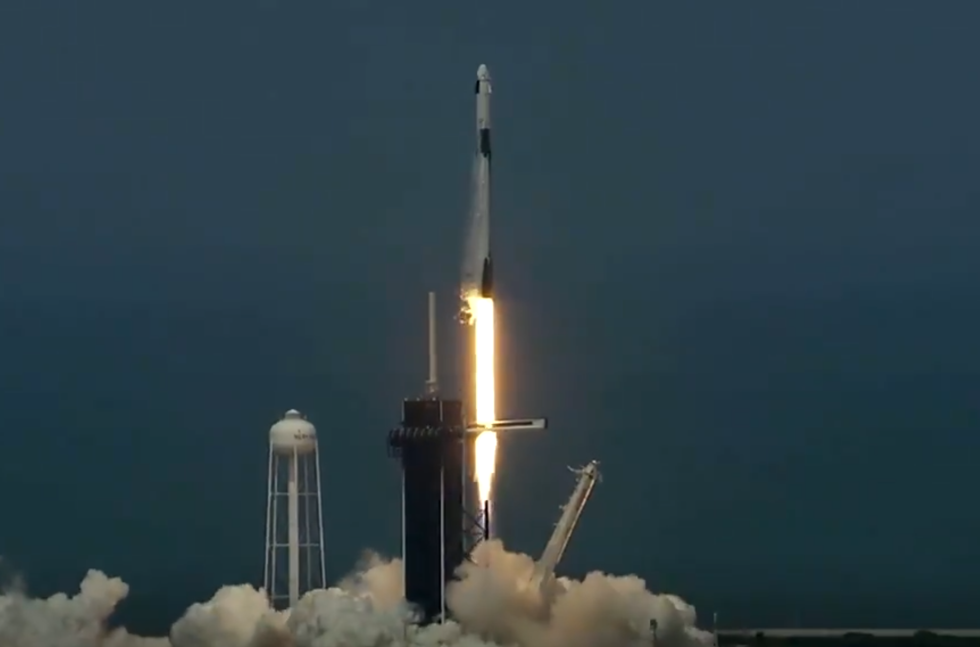 Falcon 9 booster lifts off from Kennedy Space Centrer in Florida to take Crew Dragon capsule into orbit. Image credit: SpaceX